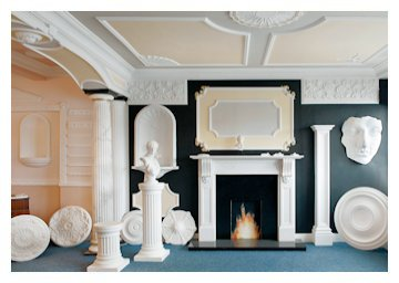 Solid white marble fireplace, panel moulds, roman niche and marbleized Harewood flutted columns.